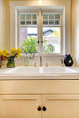 Kitchen sink and white cabinet with window. — Stock Photo