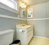 Grey bathroom with white simple cabinet. — Stock Photo