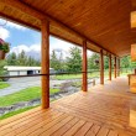 Long cabin horse farm house porch. — Stock Photo
