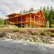 Stock Photo: Beautiful large Americclassic log cabin home.