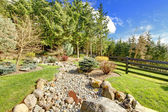 Horse farm rural landscape with rocks and forest. — Stock Photo