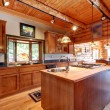 Log cabin large kitchen interior. — Stock Photo