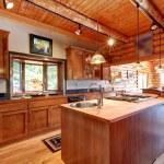 Log cabin large kitchen interior. — Stock Photo