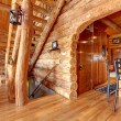 Log cabin kitchen and staircase interior. — Stockfoto