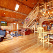 Large luxury log house living room. - Stock Photo