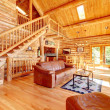 Luxury log cabin living room with leather sofa. — Stock Photo