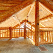 Log cabin ceiling and staircase. - Stockfoto