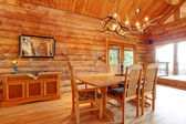Log cabin dining room interior. — Stock Photo