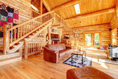 Luxury log cabin living room with leather sofa. — 图库照片