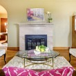 Stock Photo: Elegant gold and pink fireplace in livingroom interior.