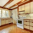Old simple white and wood kitchen with hardwood floor. — Stock Photo