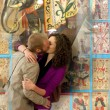Stock Photo: Couple kissing with old tarot cards background.