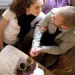 Couple is drinking tea in the living room. — Stock Photo #10412634