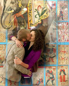 Couple kissing with an old tarot cards background. — Stock Photo