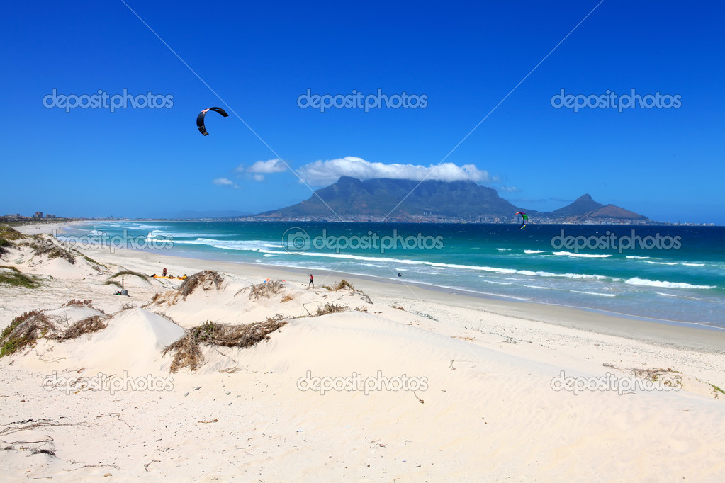 Sunset Beach with Table Mountain, Cape Town, South Africa. Stocksunset beach town