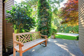 Front entrance bench with summer landscape. — Stock Photo