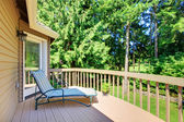 Balcony with summer back yard with pine trees — Stock Photo