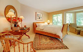 Large elegant bedroom with natural tones. — Stock Photo