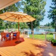 Large deck with umbrella and view of the lake — Stock Photo #8751409