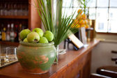 Hotel restaurant counter top with fruits and pottery. — Stock Photo