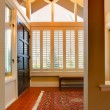 Entrance room with front black door — Stock Photo #8874099