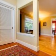 Nice large open hallway and living room with red wall — Stock Photo #8874110