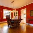 Classic red dining room with antique furniture - Stock Photo