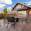 Large brown house with back deck exterior rain winter shot — Stock Photo #8874851