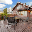 Large brown house with back deck exterior rain winter shot — Stock Photo