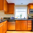 Modern cherry wood kitchen in city apartment — Stock Photo #8875176