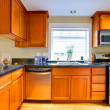 Stock Photo: Modern cherry wood kitchen in city apartment