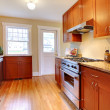 Stock Photo: New cherry kitchen with hardwood floor.