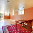 Large basement room with desk and orange walls. — Stock Photo #8877190