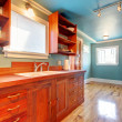 Custom build cherry kitchen with blue walls — Stock Photo #8877200