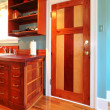 Стоковое фото: Kitchen with a beautiful wood door and hardwood floor.