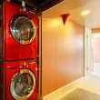 Washer and dryer in red in the basement — Stock Photo