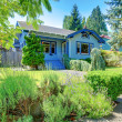 Small old cute blue craftsman one level home. — Stock Photo