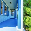 Blue house covered front porch with entrance door. — Стоковая фотография