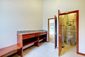 Utility Laundry room with desk and water heater — Stock Photo