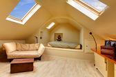 Adorable attic bedroom with unique design — Stock Photo
