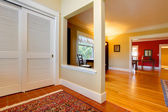 Nice large open hallway and living room with red wall — Stock Photo