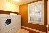 Laundry room with gold colors — Stock Photo