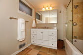 Luxury classic basement bathroom with white and beige — Stock Photo
