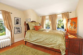 Antique bedroom with green silky bed — Stock Photo