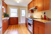 New cherry kitchen with hardwood floor. — Stock Photo