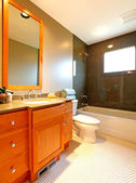 Bathroom with cherry cabinet and marble tub — Stock Photo