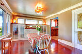 Beautiful dining room with shiny cherry hardwood. — Stock Photo