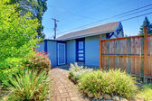 Small garage in back yard with fence. — Stock Photo