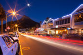 Night shot of Capms Bay street with Mountains. — Stock Photo
