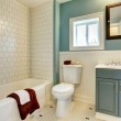New remodeled blue bathroom with classic white tile. — Stock Photo #9184085